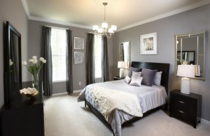 comfort black queen bedroom with smooth light grey wall paint and mini iron chandelier with five glass lampshades