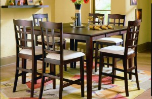 comfort dining area with energetic yellow wall and pub style dining table plus expandable top