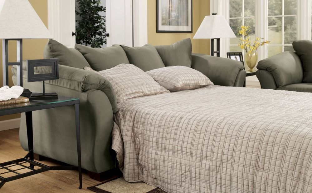 comfort living room with light grey love sleeper sofa with bed and plaid bedding sets