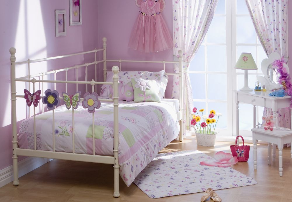 comfortable and lovely bedroom for girls with pink floral curtains and metal bedframe