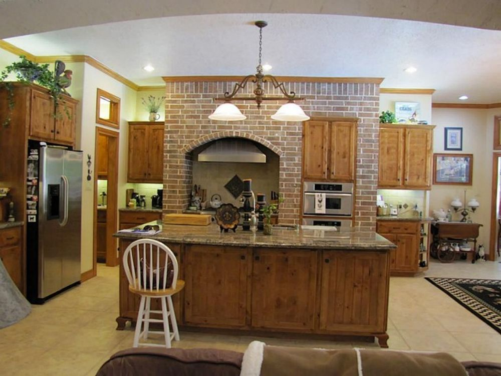 country kitchen style with brickwork wall design and traditional over cabinet light