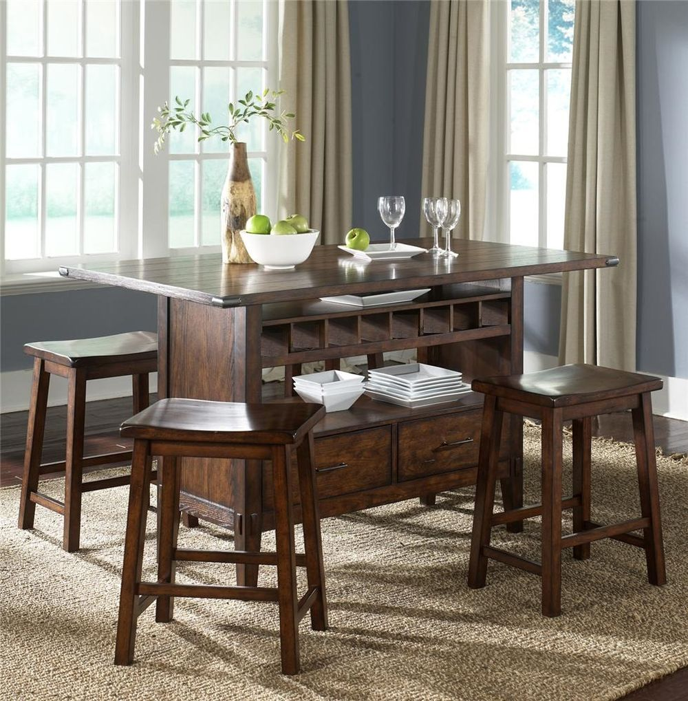 cozy dining room interior with pub style dining table and glass racks also storage