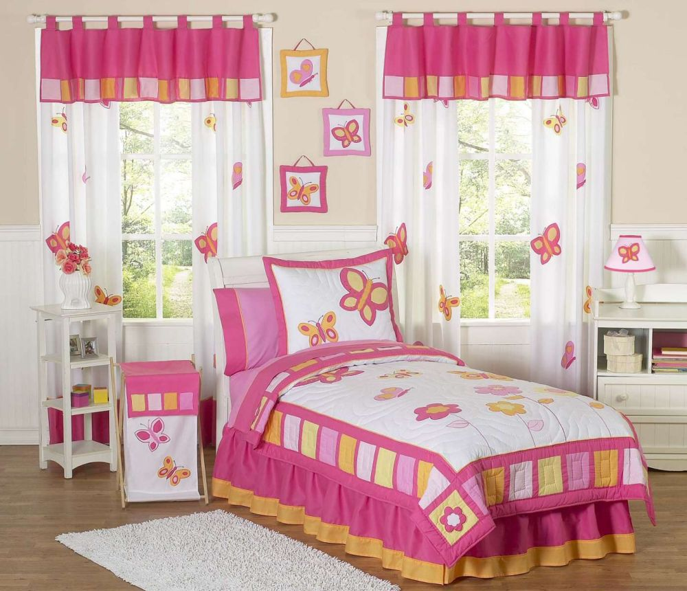 cute bedroom for little girl with butterfly themed decoration and beautiful floral bedding