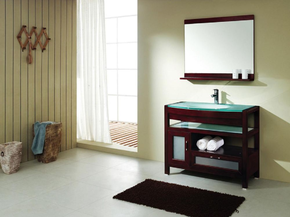dark wood menards bathroom vanity with turquoise top accent and frameless wall mirror
