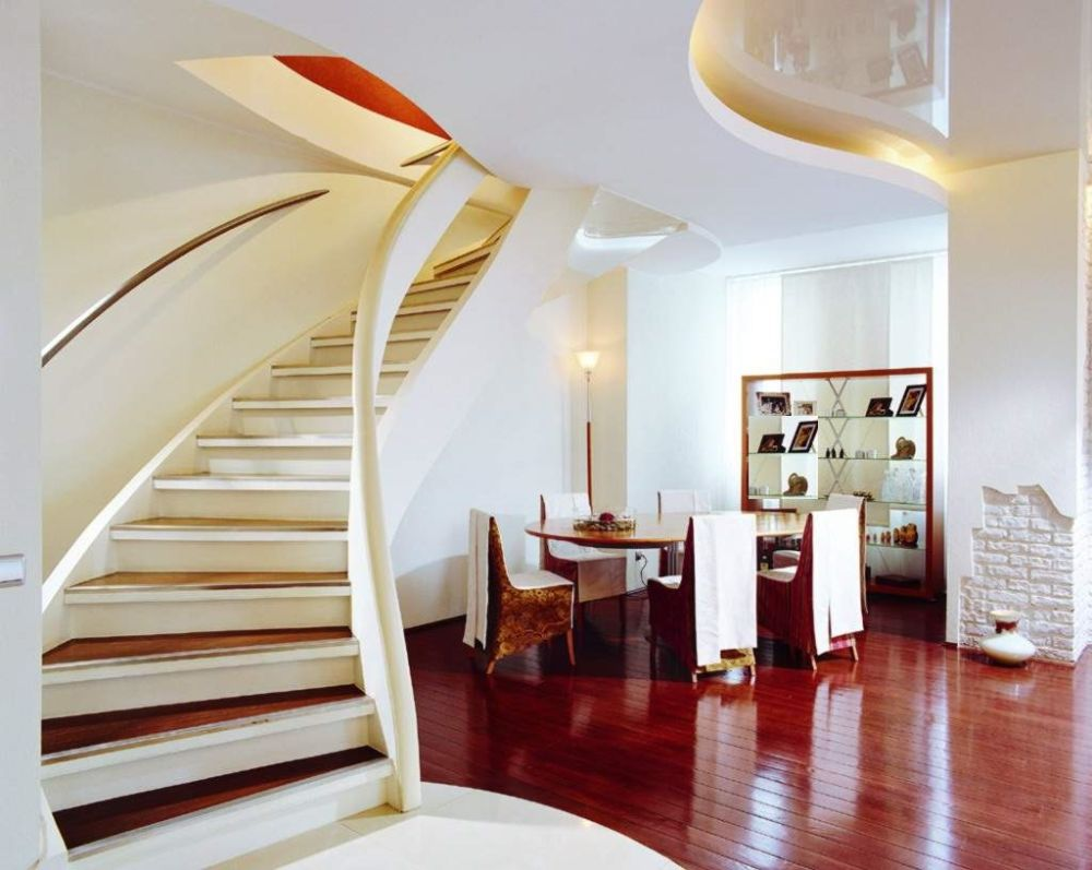 elegant dining area under stair with big ellipse table and charming shabby chic chairs in brown color