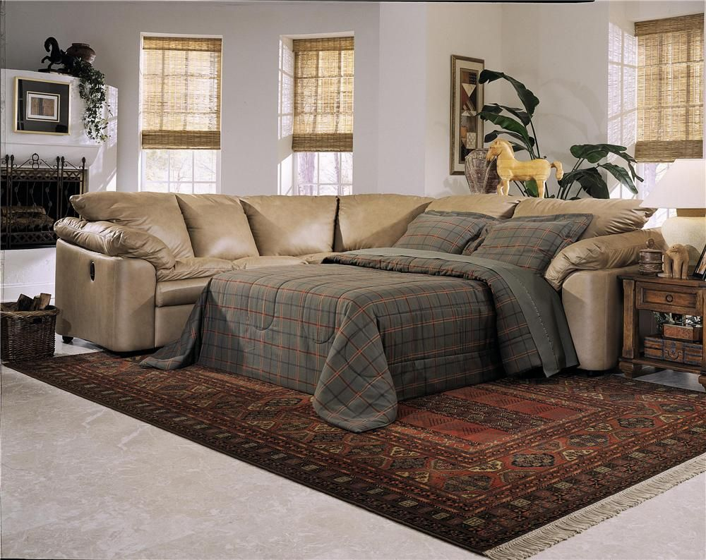 Elegant Living Room with L-Shaped Sleeper Sofa From Creamy Tone Leather Cover and Calming Dark Grey Bedding Sets