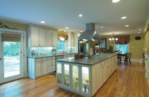 elegant spacious kitchen design with over cabinet light and wide top kitchen island plus kitchen hood