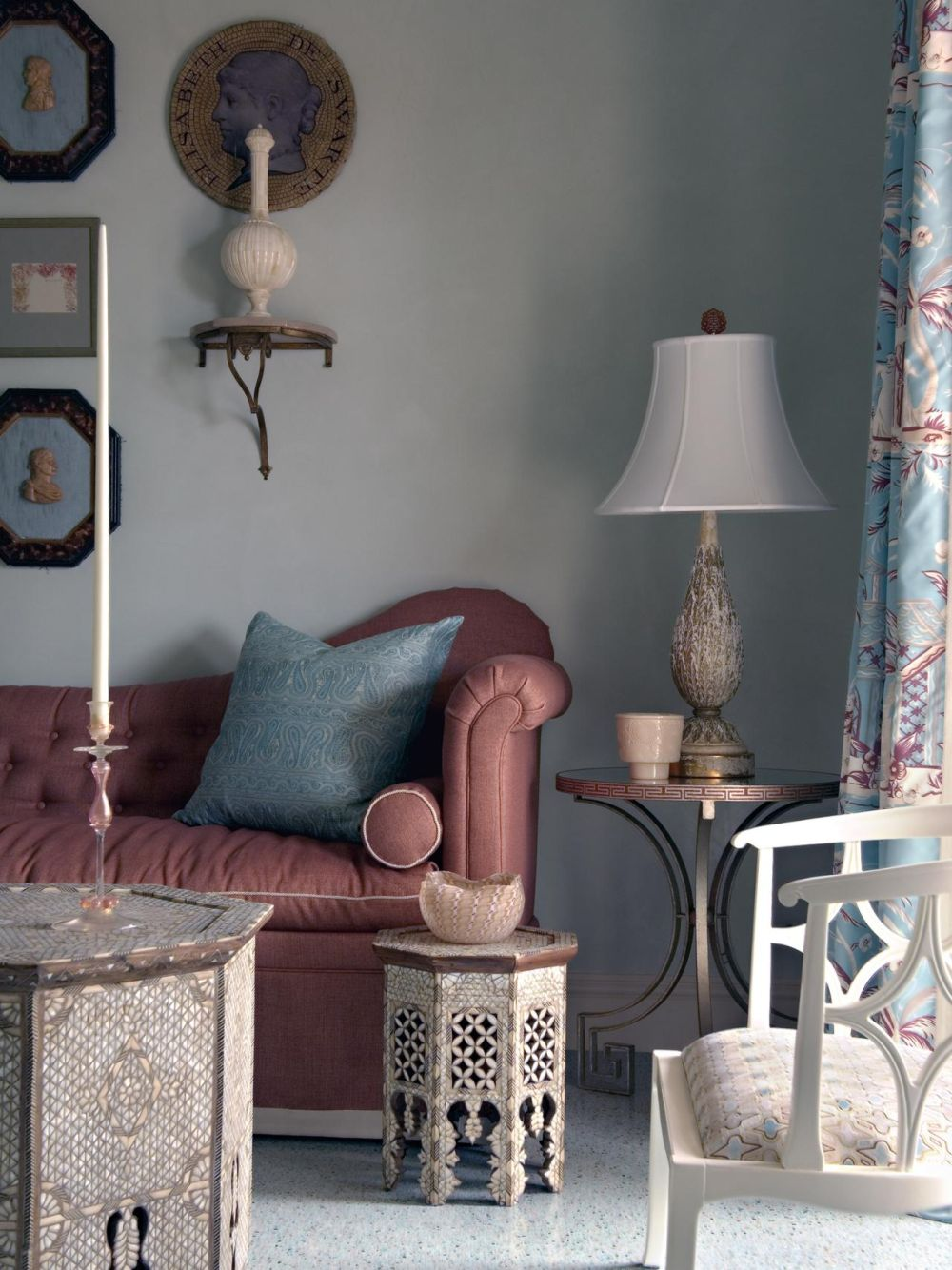 grey living room with two moroccan side table and artistic white table lamp