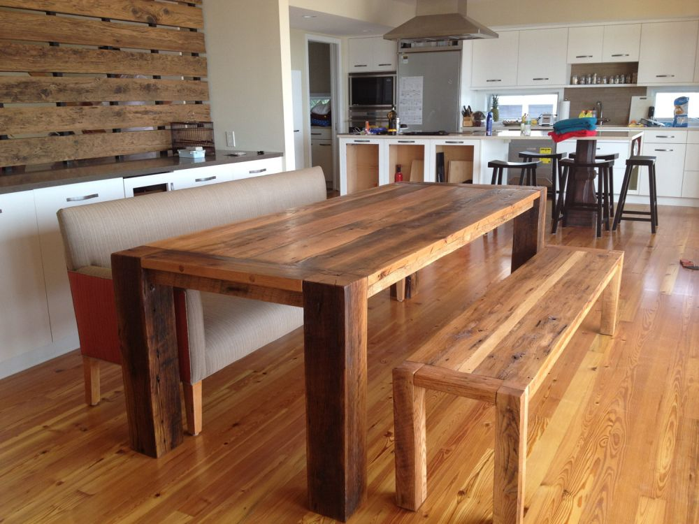 long narrow pallet dining table with wooden bench in dining room