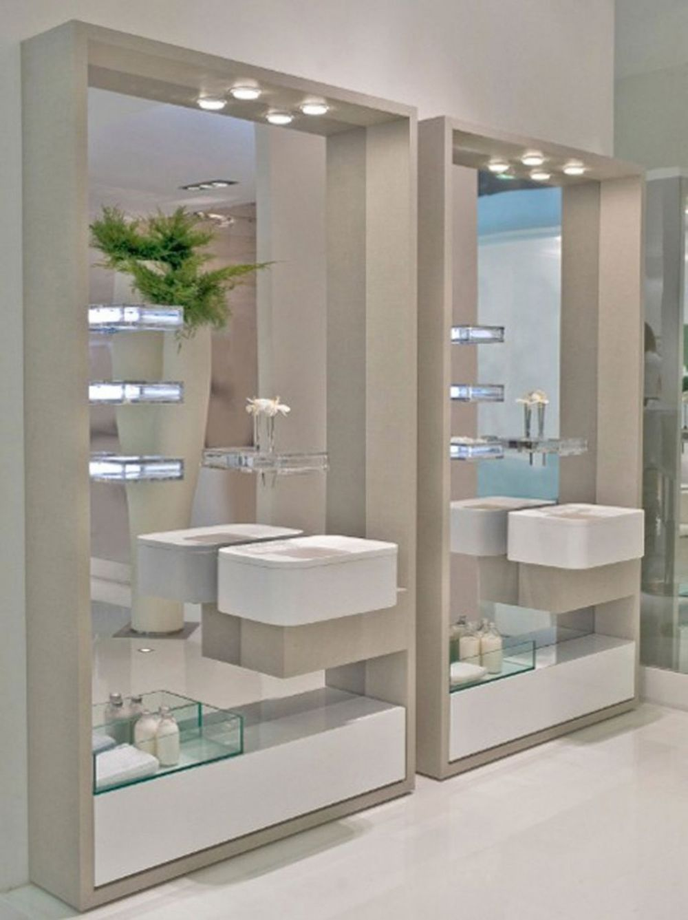 luminous glass shelves on frameless built-in mirrors with white trough sink cabinets and powder room