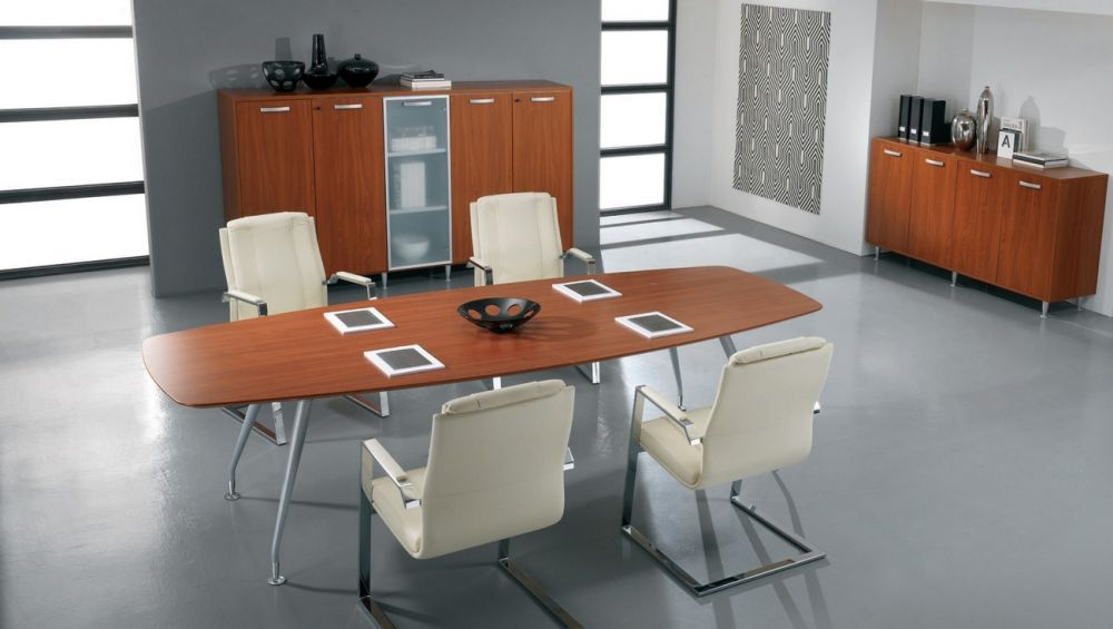 modular shaped conference table with catchy stainless steel legs and white upholstered chairs