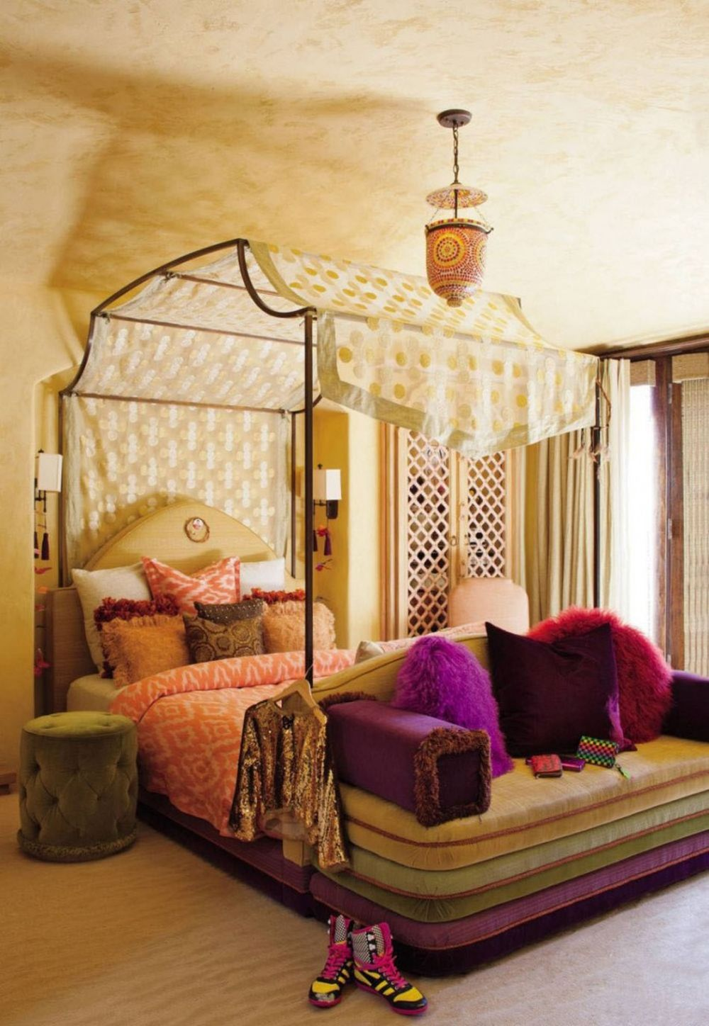 moroccan style white bedroom with nice upholstered side table and gorgeous canopy bed with bench