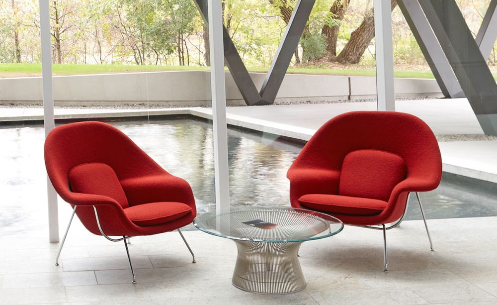 perfect platner coffee table in backyard with two red couch chairs