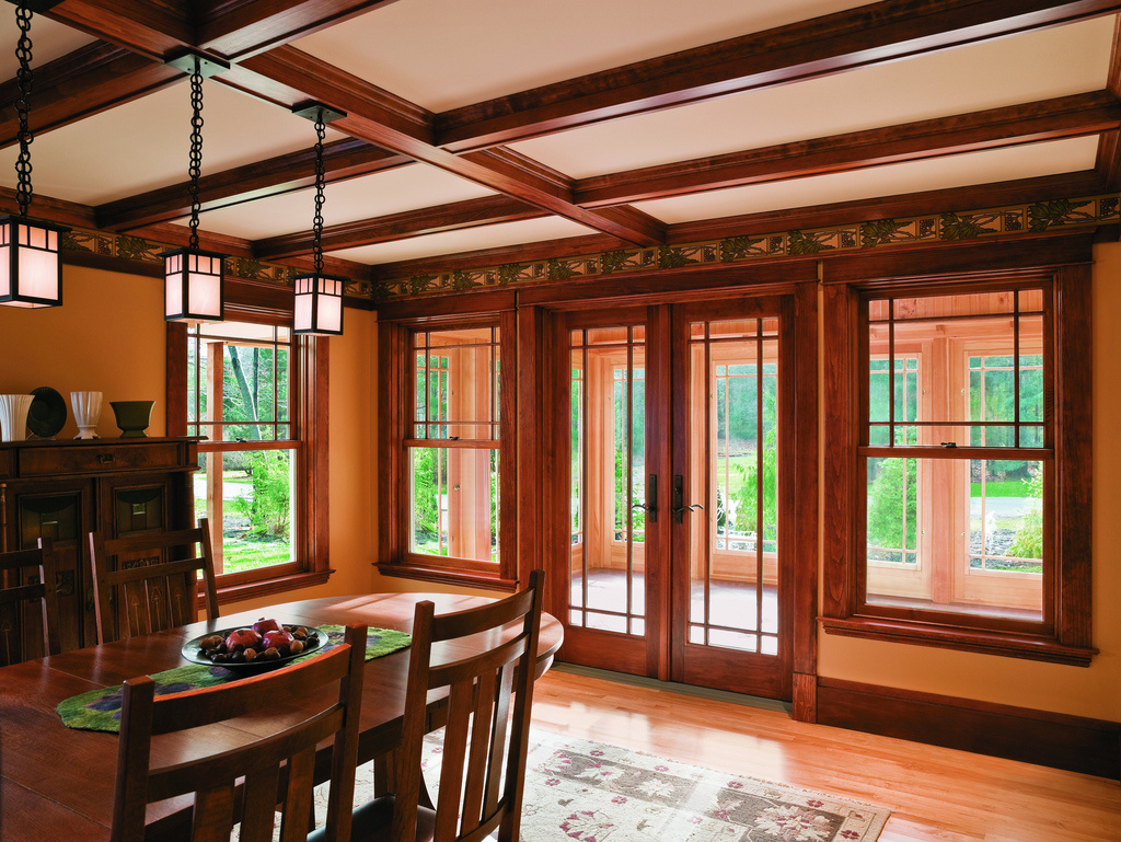 renovated dining room with renewal by anderson put traditional window designs and using decorative wood beams