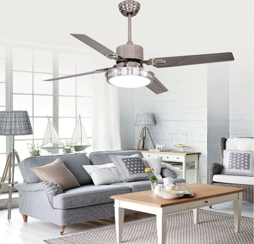 scandinavian living rooom style with natural light and quiet large ceiling fan with light