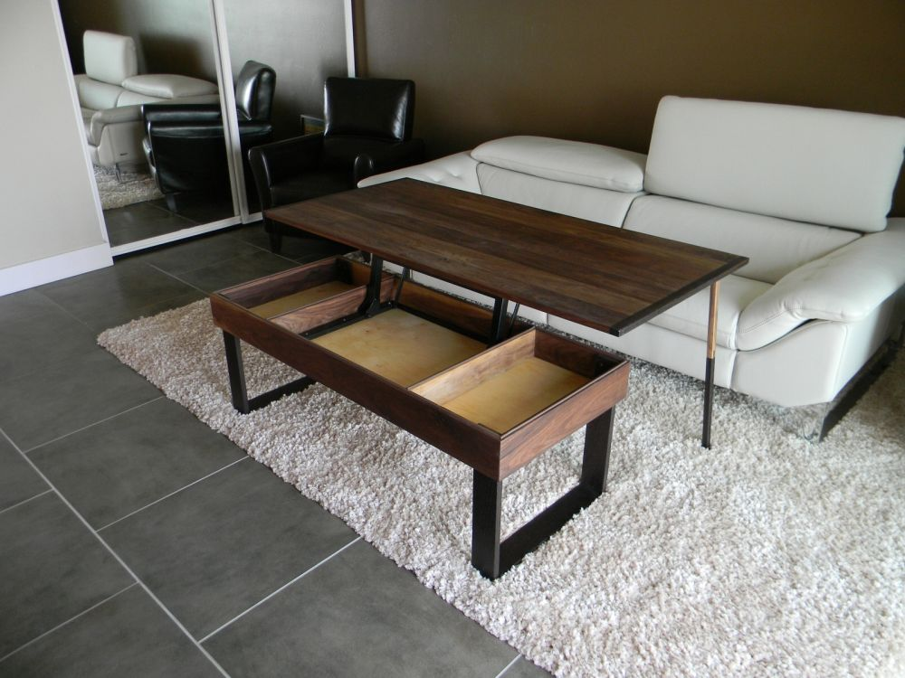 simple pop-up coffee table supported by tough black metal base with three functional storage spaces