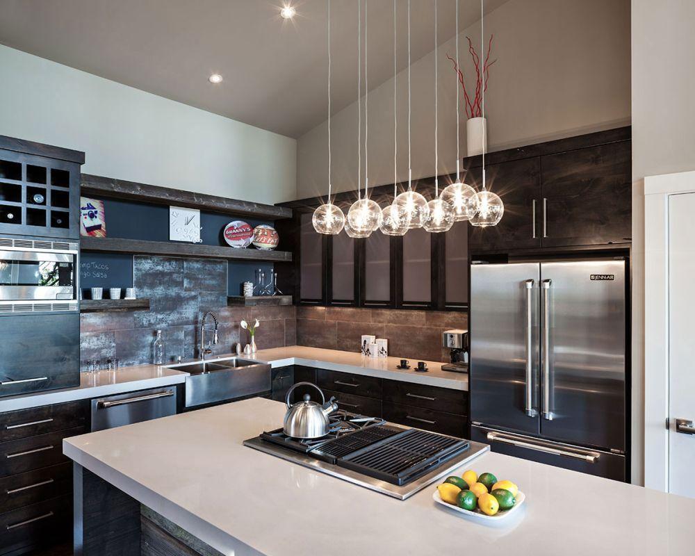 sleek kitchen island design with granite countertop and decorative hanging lamp