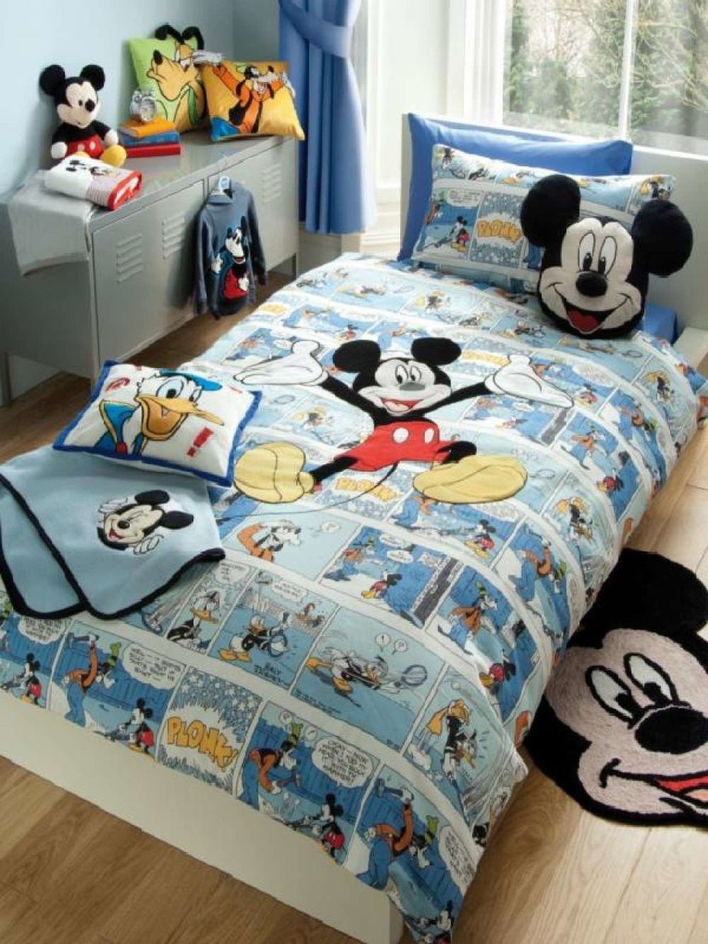 small bedrom design with Mickey mouse accessories and pillow plus cabinet
