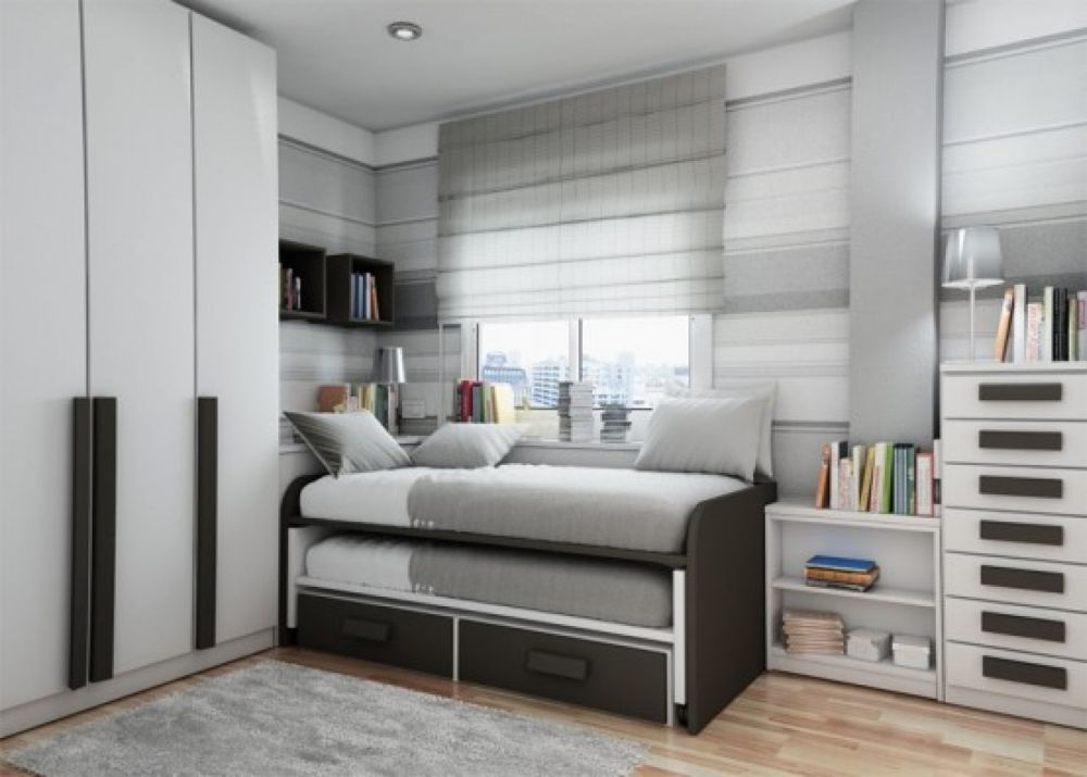 space saving bedroom design for teenager with elegant light grey wall paint idea and black trundle bed with double mattresses