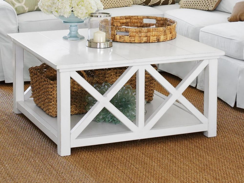 square shape nautical coffee table in white color with x shaped pattern and rustic shelf