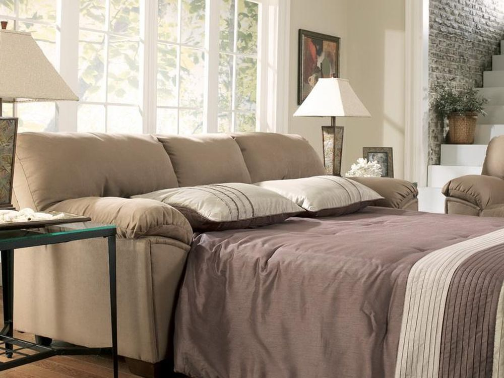 Tranquil Luminous Living Area with Beige Microfiber Loveseat with Bed and Two Charm Table Lamp