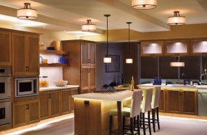 ultra modern large kitchen island with brilliant lighting fixture and massive wood storage