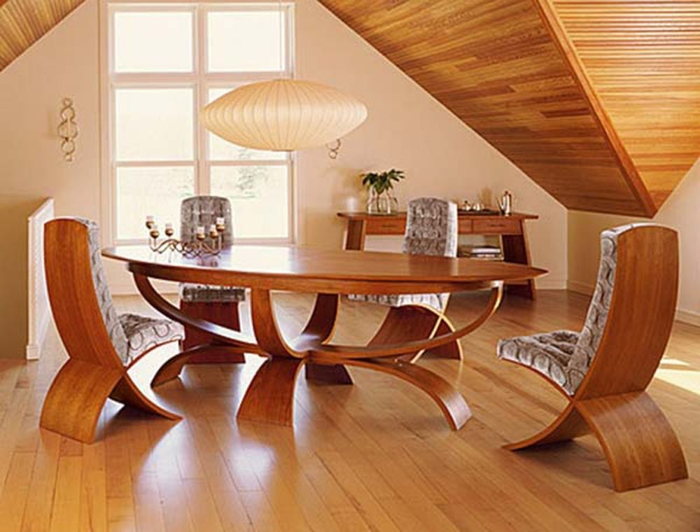 unique dining room design with unusual oval table with spherical feet and unique IKEA dining chairs