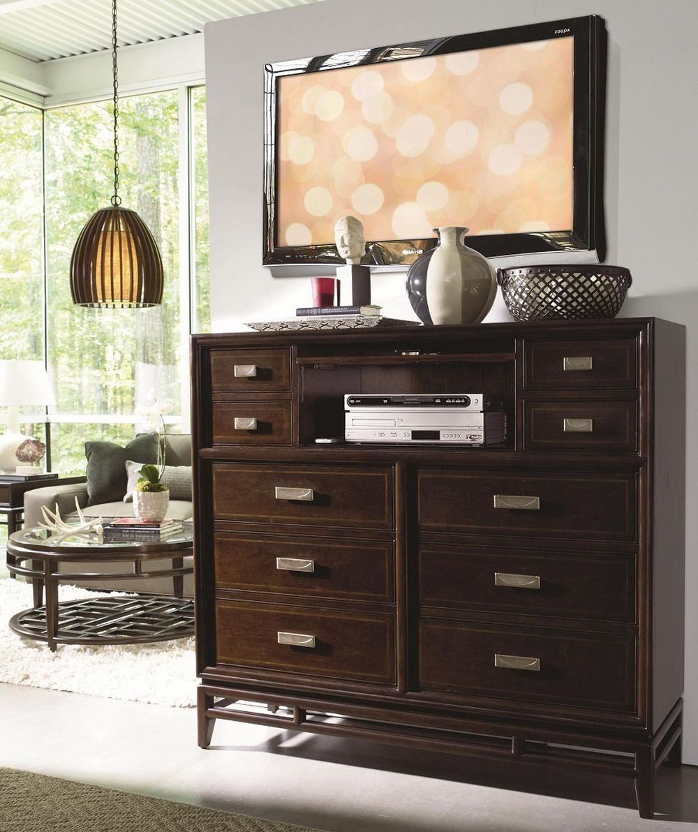 wooden chests of drawers with mounted flat-screen television on wall