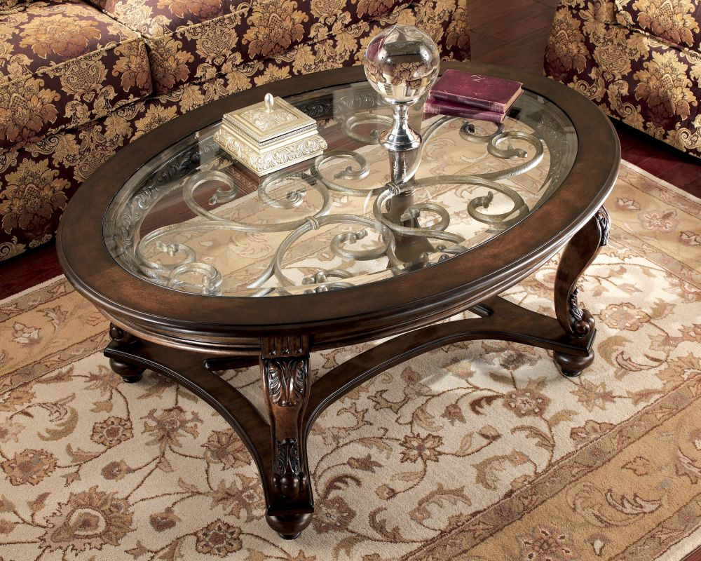 wooden round norcastle coffee table with glass top and carved wooden legs