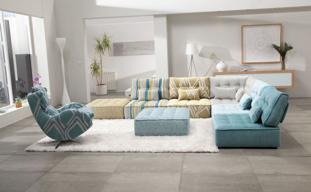 large living room with white walls and turquoise seating square ottoman standing on a luxurious white furry rug remarkable sectional sofas inducing elegance and warmth in houston homes