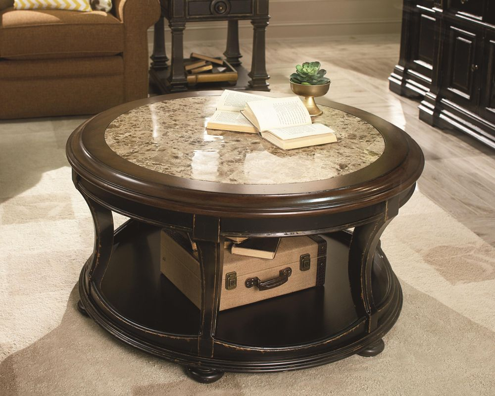 exquisite round shaped table with light grey granite top and glossy hardwood frame enhancing the living room with stone top coffee table