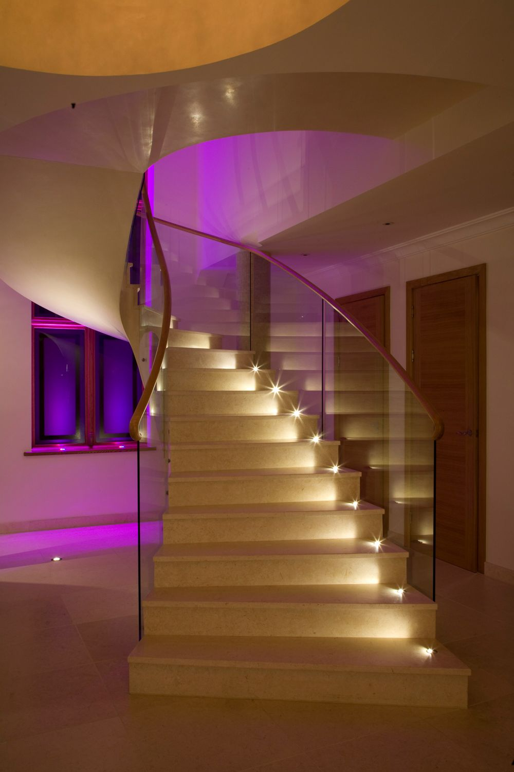 pretentious helical staircase with exotic purple led lighting from behind and above wall decor stunning stairwell lighting ideas for awesome staircase outlook