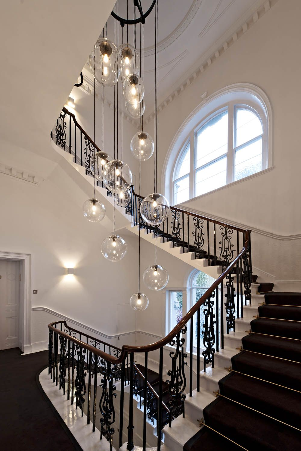 traditional spiral staircase with round globe filament pendant lighting stunning stairwell lighting ideas for awesome staircase outlook