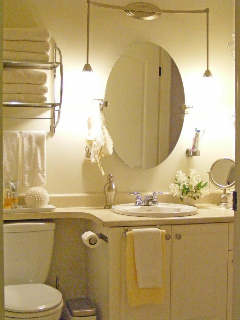 adorable oval mirror in the white scheme bathroom design with wall lamps unique bathroom mirrors to enhance the design