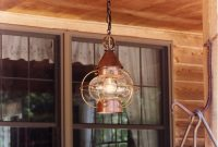hanging light fixture in dark brown metal shade and gold themed brass frame antique western light fixtures that always dazzle from time to time