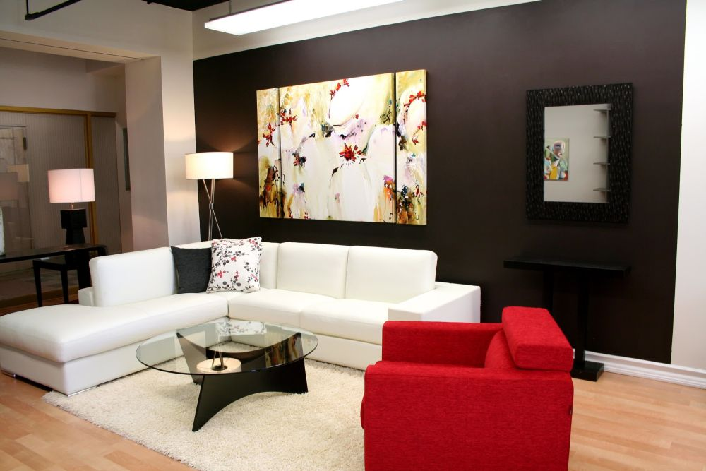 modern living room wall decorating ideas with artistic painting and combined white l-shaped sofa entertaining wall decoration for living room design