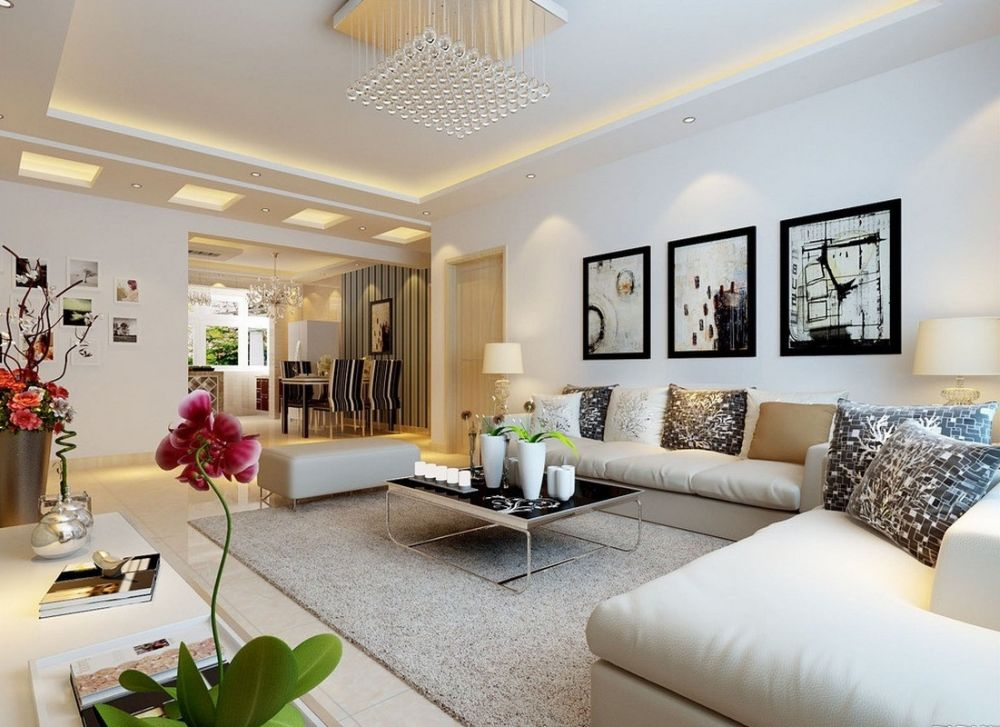 white scheme living room with white palette and some artsy paintings on the wall entertaining wall decoration for living room design