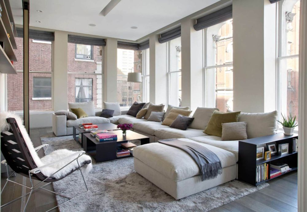 comfortable living room with white long sofa and colorfull cushions dizajn interera v stile loft presenting best interior design with extra long sofa