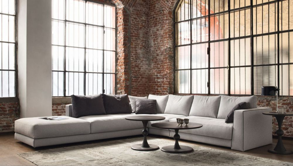 extra long gray sofa with black cushions in rustic nuance living room presenting best interior design with extra long sofa