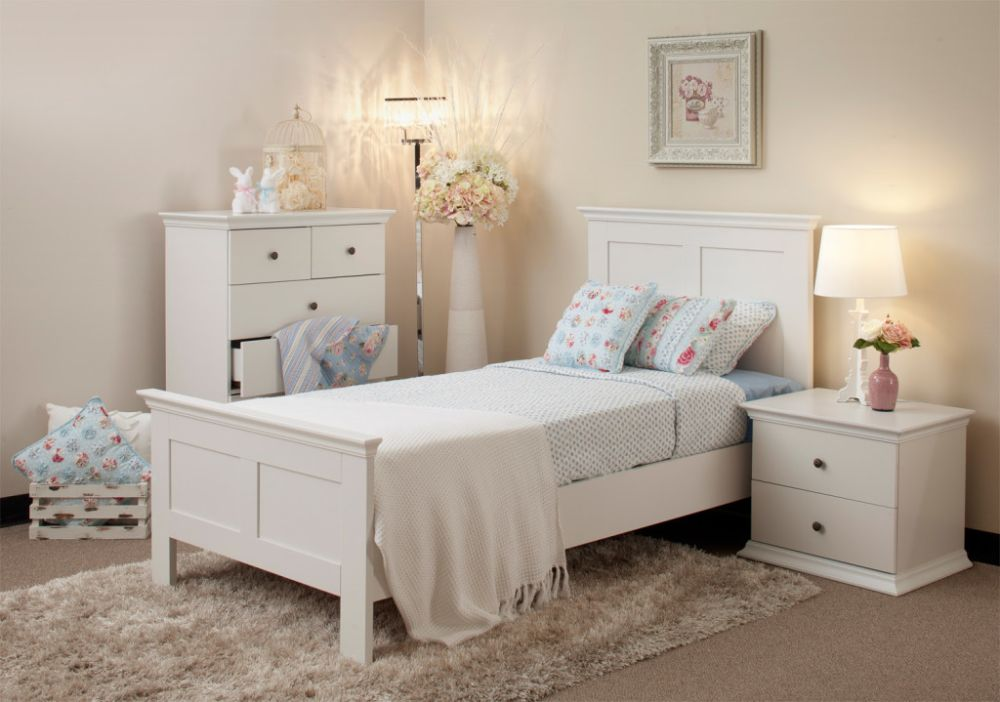 small platform bed with simple ornamentations and blue bedding set which looks calm white bedroom furniture with some interesting wicker accents
