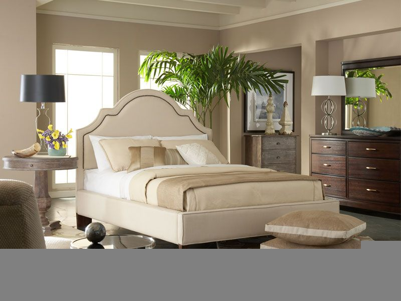 white cushioned bed featuring leather coating and stylish black feet excellent ideas for california king bedroom sets