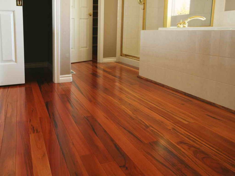 bathroom with cherry wood floor planks and calming dark brown tone and lacquer finishing rejuvenating for bathroom flooring options
