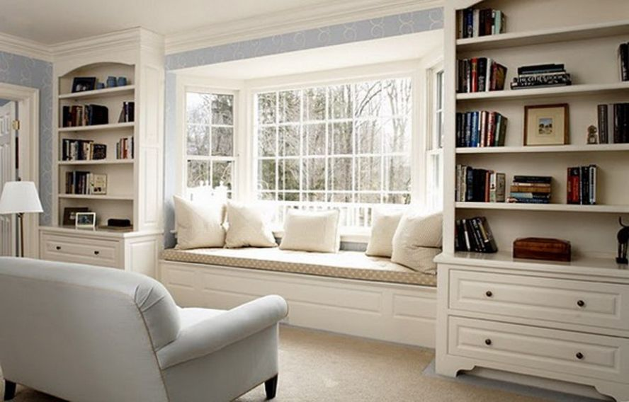 stunning bay window with white wooden bookshelves and cabinet getting the right atmosphere in the upper floor expansion with oriel window ideas