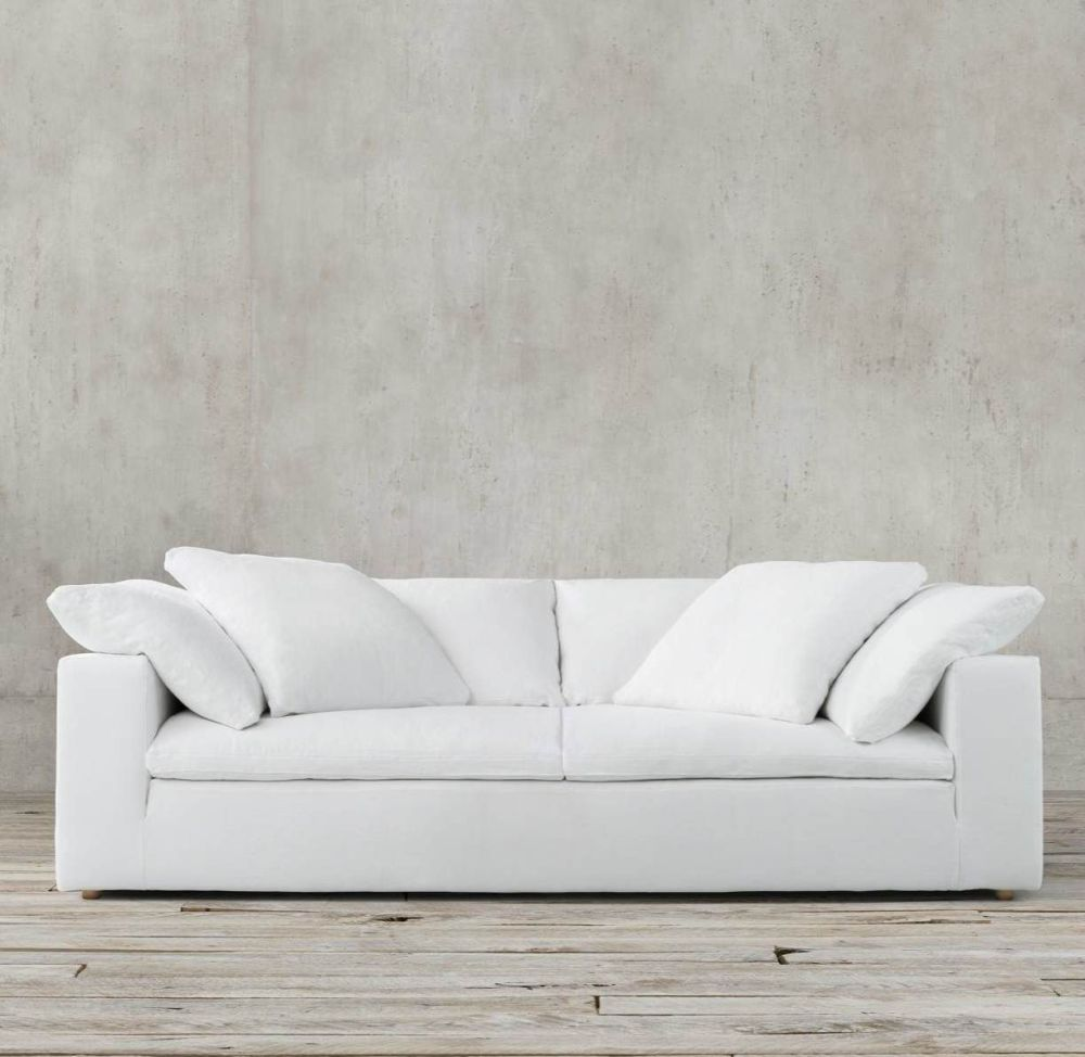 white modern slipcovered cushion sofa by Restoration Hardware the great seating debate about sofa versus couch: which one is better